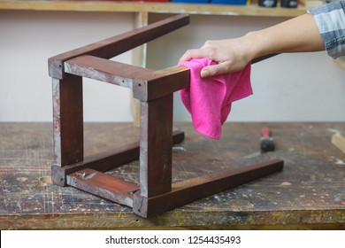 woman cleaning furniture in preparation for painting