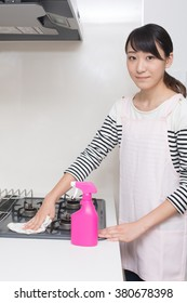 woman cleaning up her kitchen
