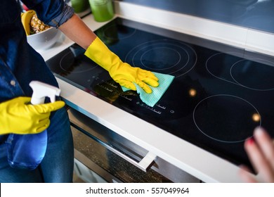 Woman cleaning up in the kitchen