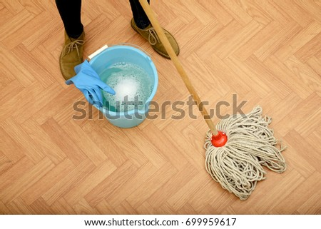 Woman Cleaning Parquet Floor Stock Photo Edit Now 699959617