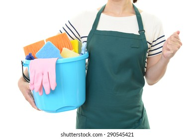 Woman with a cleaning tool