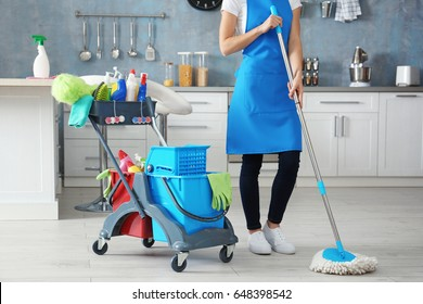 Woman with cleaning tools at home