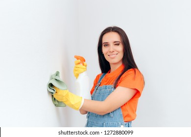 Woman Cleaning Washable Paint in House Cleaning Session. Girl doing housekeeping tasks washing the walls in her apartment