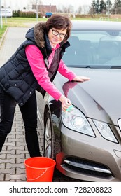 Woman cleans the car