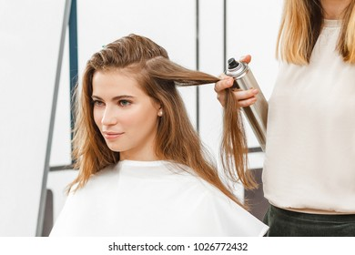 Woman client at the coiffeur and hairdresser salon, stylist and fashion concept