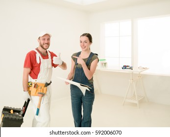 woman client and contractor talking, laughing at renovation site, apartment
