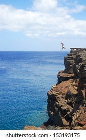Woman Cliff Jumping in Hawaii