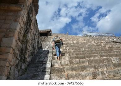Woman climb up at Acropolis of Mayan archeological site of Ek Balam (black jaguar). This ancient Mayan site Ek Balam is located 30 km from center of town Valladolid. Yucatan Peninsula, Mexico.
