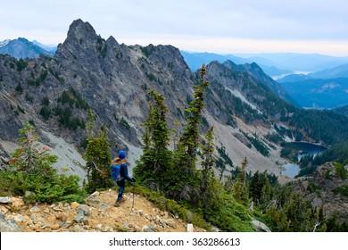 Woman Climber Looking Towards Mountains and Lake.  Kaleetan Peak, Snoqualmie Pass, Washington