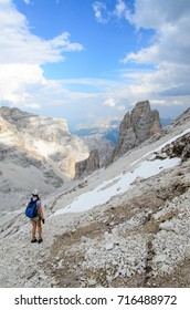 Woman climber at via ferrata, giovanni lipella, dolomites, italy