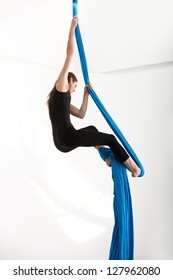 Woman climbing up with acrobatic tissue