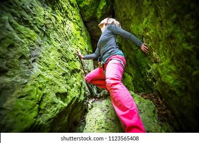 Woman climbing free solo