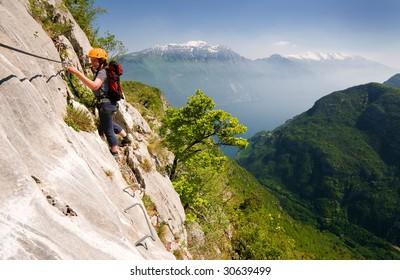woman climbing on ferrata in italy