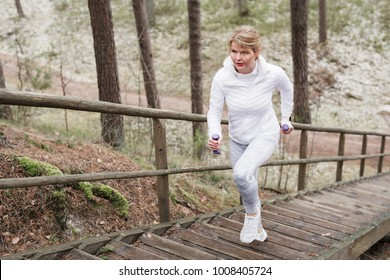 Woman climbing stairs during exercise outdoors