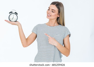 Woman with clock in hands, time management concept. Young female girl pointing clock.
