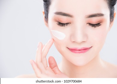 woman close eyes and touch face with beauty skin care concept