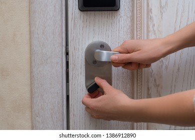 Woman closes door lock deadbolt
