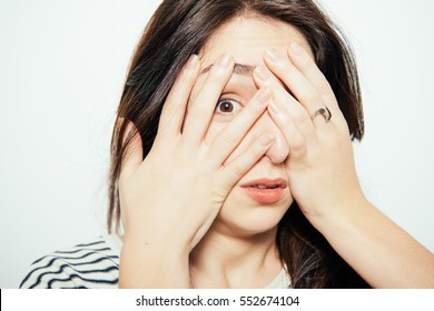 woman closes eyes with her hands