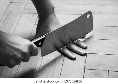 Woman closeup cutting the fingers with knife