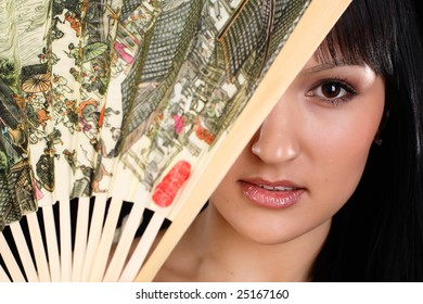 Woman closing her face with fan