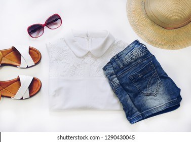 Woman clothes and accessories set on white background top view. woman trendy fashion clothes. modern and casual outfit. fashion, shopping and makeup concept.  Flat lay female casual style look.