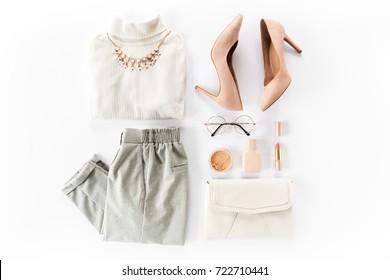 Woman clothes and accessories set on white background top view. modern and casual outfit. fashion, shopping and makeup concept. Flat lay, top view.