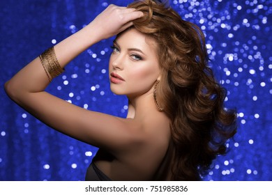 Woman club lights party background Dancing girl Long hair. Waves Curls Updo Hairstyle. Fashion model in salon with shiny healthy luxurious haircut.  Jewelry Bracelets Earrings
