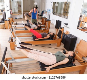 woman with a coach in the gym with modern exercise equipment
