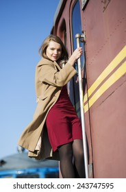 Woman in coat and brown wagon from stain