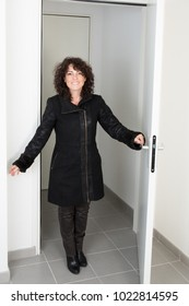 woman with coat entrance home or estate property