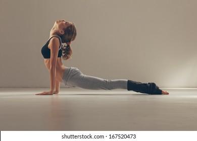 Woman in the Cobra yoga pose.