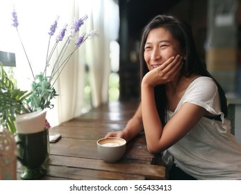 Woman in coffee shop with a cup of coffee