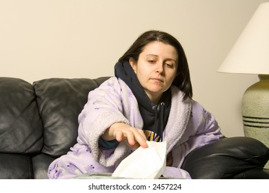 woman with a cold reaching out for a tissue