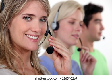 Woman and colleagues wearing headsets