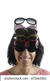 Woman with a collection of sunglasses over white
