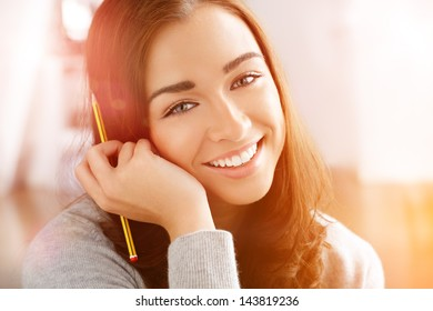 Woman college student studying at home portrait smiling