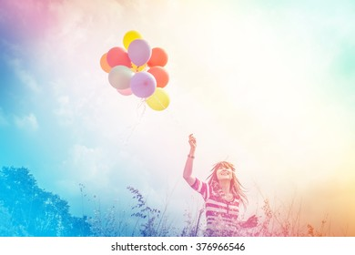 Woman with colorful Balloons in the Park,Outdoors lifestyle filters images