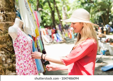 woman with colorful clothes outdoors at typical traditional market