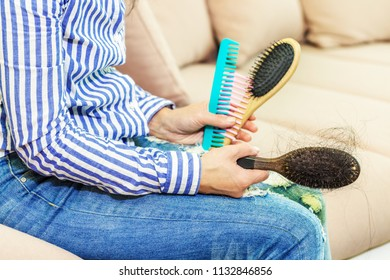 Woman with  combs on couch
