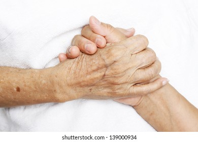 Woman Comforting Hand with Old woman