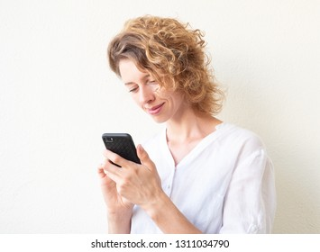 Woman communicaties by phone; white background