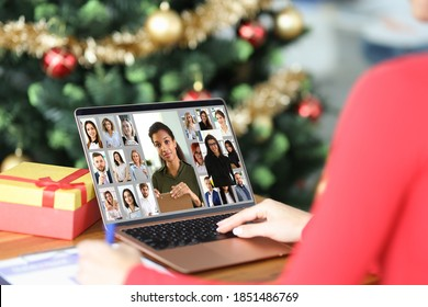 Woman communicating with group of business people by video link at home near Christmas tree close-up. Remote work on isolation during pandemic covid 19 concept - Shutterstock ID 1851486769