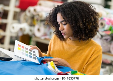 woman comparing fabric color to color preferred by her client