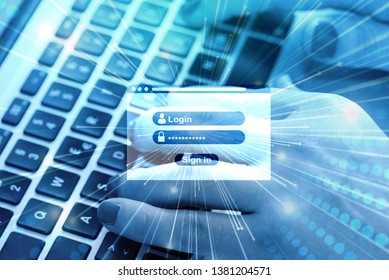 A woman at the computer types in her username and password