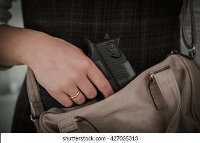 Woman with Concealed Weapon
