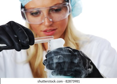 Woman conducting a chemical experiment