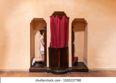 woman in the confessional on the church