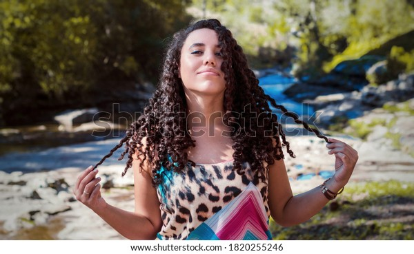 woman-confident-smile-holding-her-600w-1