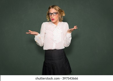 Woman confused clueless helpless unsure puzzled baffled blank funny expression space for print