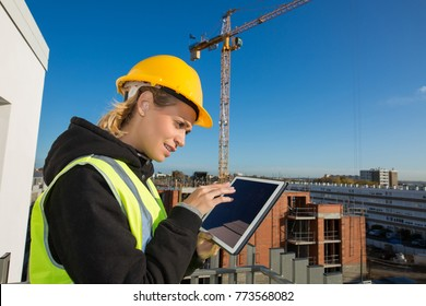 woman construction worker with hardhat using tablet pc